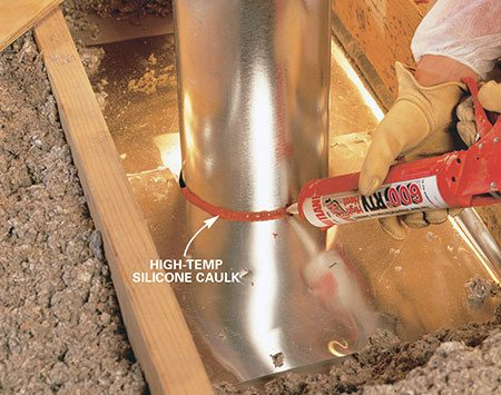 <b>Photo 6: Seal the gap</b></br> Seal the gap between the flue and metal flashing with special high-temperature silicone caulk. Don't use spray foam here.