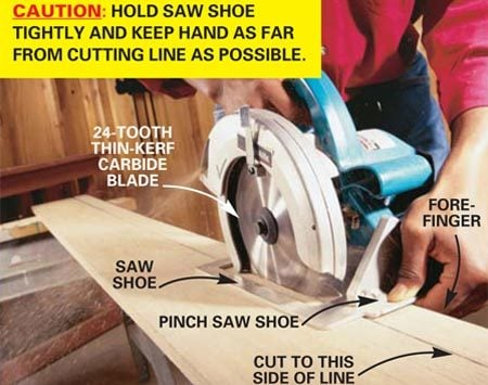 <b>Photo 3: Carefully position your finger</b></br> Position your forefinger under the saw shoe and tight to the edge of the board and pinch the shoe of the saw between your thumb and forefinger. Now make sure the saw blade is 1 in. back from uncut wood and start the saw. Guide the saw along the line, sliding your forefinger along the edge of the board as you cut.