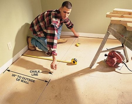 <b>Photo 1: Lay out the closet walls</b><br/>ROLL back the carpet and pry off the baseboard. Then measure out 30 in. and chalk a line parallel to the wall.