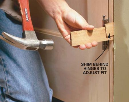 <b>Photo 10: Hang the doors</b></br> HANG the doors in the frame. Adjust the shims until the space between the two doors is even from top to bottom and the doors line up across the top. Then drive a second nail at each shim location. Add shims at the top center to stiffen the top jamb.