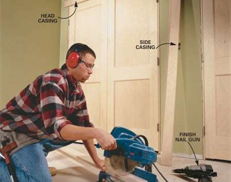 <b>Photo 13: Trim the doors with casing</b></br> MARK AND CUT trim to fit around each opening. Fasten the trim with pairs  of finish nails placed about 16 in. apart and driven into the door jamb and  framing. Install the roller catches at the door tops, and dummy knobs that  match your décor.