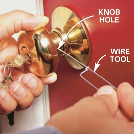 <b>Photo 1: Remove the knob.</b></br> Insert the wire tool (included in the kit) into the knob hole and depress the knob clip. Pull the knob off the door.