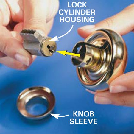 <b>Photo 2: Remove the cylinder </b><br/>Push the cylinder out the back of the knob assembly to pop off the knob sleeve, and remove the cylinder.