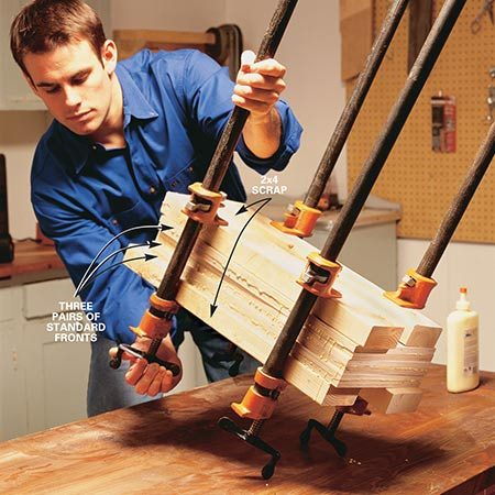 <b>Photo 3: Clamp the pieces</b></br> <p>Clamp three laminated pairs (A) together using 2x4s to help distribute the pressure evenly across the sheet surface. Leave the assembly clamped for at least two hours.</p>
