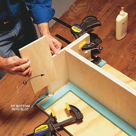 <b>Photo 5: Add parts C</b></br> <p>Glue and clamp parts C to each standard. Be sure to glue around the perimeter of each piece and also run a bead of glue along the inside corner. Use as many clamps as necessary. For tall standards you may need up to four clamps per side. Remove the standard from the jig and glue another standard together while the glue sets.</p>