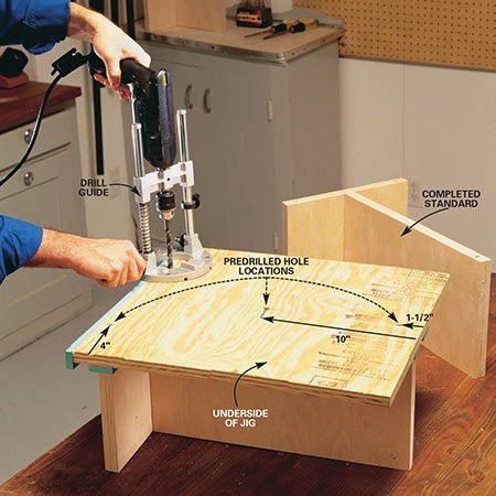 <b>Photo 6: Drill holes for the steel pins</b></br> <p>Drill 25/64-in. dia. holes 1 in. deep into the tops and bottoms of the standards at the locations shown in Fig. B. We used a portable drilling guide (available at home centers) for precise perpendicular holes. You can also use a drill press, if you have one. If you have a good eye for drilling straight holes, you can drill freehand.</p>