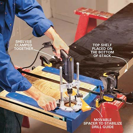 <b>Photo 8: Drill pin holes</b></br> <p>Drill the pin holes in the shelves using the same 25/64-in. drill bit and an accessory fence screwed to the jig. The auxiliary fence positions the jig automatically to ensure consistent overhang from the standards. Be sure to set the depth stop on your drill so you don't drill through the top piece of your shelving unit, which is located on the bottom of the stack as shown.</p>