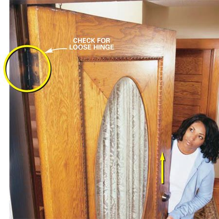 <b>Photo 1: Tighten the hinges</b></br> Lift the door by the doorknob to check for loose hinges. If the door moves upward, tighten the top hinge screws. That might solve the draft problem!