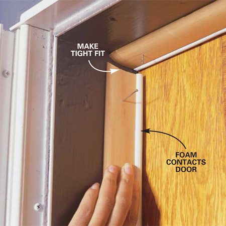 <b>Photo 6: Adjust the cut</b></br> <p>File or sand your cut for a tight fit. Then measure and cut the bottom to length (Photo 3). Position the weatherstripping so that the entire length seals to the door and tack it in place.</p>