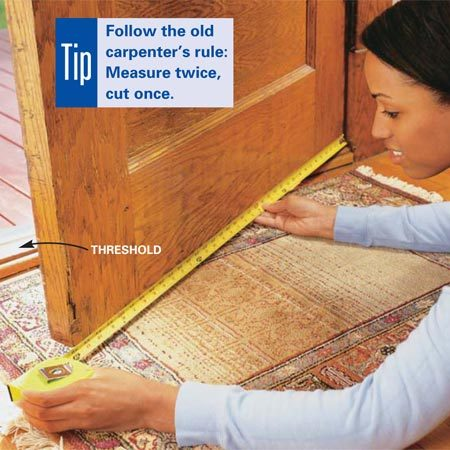 <b>Photo 8: Measure for a door sweep</b></br> <p>Measure the width of the door from inside and mark the length on your new sweep.</p>