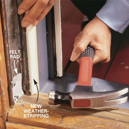 <b>Photo 12: Seal the bottom corners</b></br> <p>Cut two 2 x 1-3/4-in. pads from 1/8-in. thick felt. Nail the pads at the bottom of each side frame as shown. Open and shut the door and adjust the pads if necessary.</p>