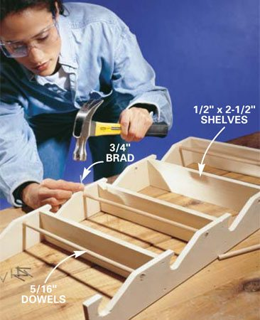 <b>Photo 3: Assemble the rack </b></br> Glue and nail the shelves in place one at a time, using 3d finish nails. Then use 3/4-in. brads to pin the dowels in place. Sink all nailheads using a nail set. Apply polyurethane or other finish to match the cabinets.