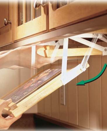 <b>Swing-down cookbook rack</b></br> Swing-down racks tuck up under cabinets and out of the way.