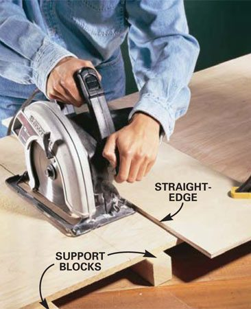 """<b>Photo 1: Use a straightedge and saw to cut the base to size. </b></br> Cut the 1/2-in. thick plywood base to size. To get straight cuts, measure from the edge of your circular saw base to the edge of the blade, then clamp a straight board to the plywood that distance from your cutting line to serve as a guide. Cut with the plywood's """"good"""" side down."""