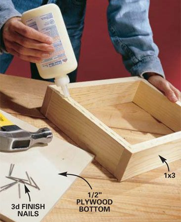 <b>Photo 1: Assemble the shelves. </b></br> Glue and nail the 1x3s together using 4d finish nails, then secure the plywood bottom with 3d finish nails.