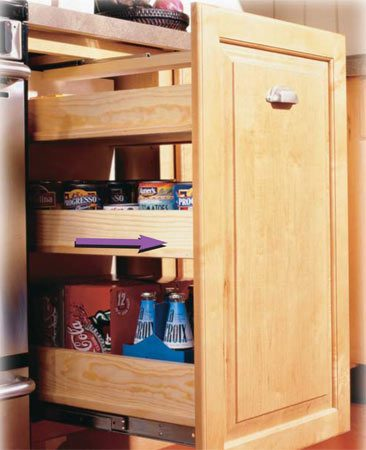 <b>Roll-out cabinet</b></br> Roll-out shelves open up inaccessible space in the back of deep base cabinets.