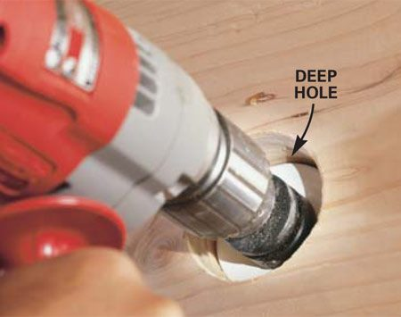 <b>Photo 9: Finish the hole</b></br> Repeat the drilling and chiseling process until you're all the way through.
