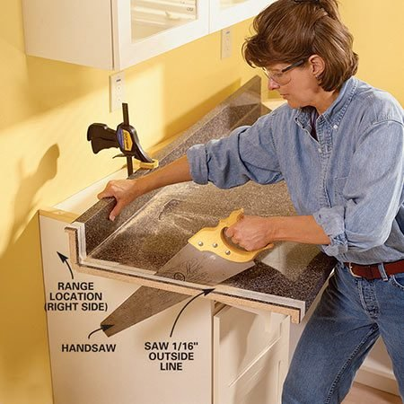 <b>Photo 11: Use a handsaw to cut the countertop</b></br> Trim the end of the countertop with a sharp 10-tooth-per-inch handsaw. First apply masking tape over the edge and then mark the cutoff line with a pencil. Cut 1/16 in. outside the mark and then belt-sand to the line. Next, glue (use carpenter's glue) and clamp a buildup strip onto the underside of the top and flush with the edge.