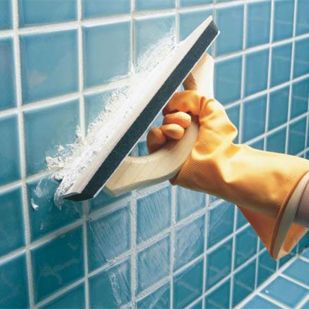 <b>Photo 2: Spread the grout</b></br> Using a grout float, push the grout diagonally across and into the vacant joints.