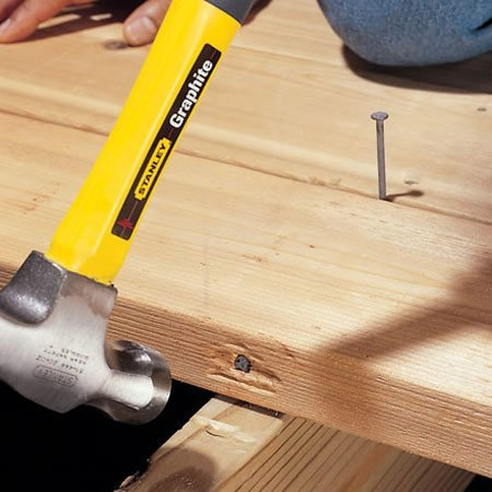<b>Use the toenail trick to position lumber</b></br> On my first job as a framing carpenter, I was beating on a stud to try to coax it into position. The stud just bounced back. A veteran framing carpenter walked over and drove a big nail at an angle through the edge of the stud. The last two hammer blows moved the stud into position, where it stayed. Now I use the toenail trick whenever I need to adjust stubborn lumber.
