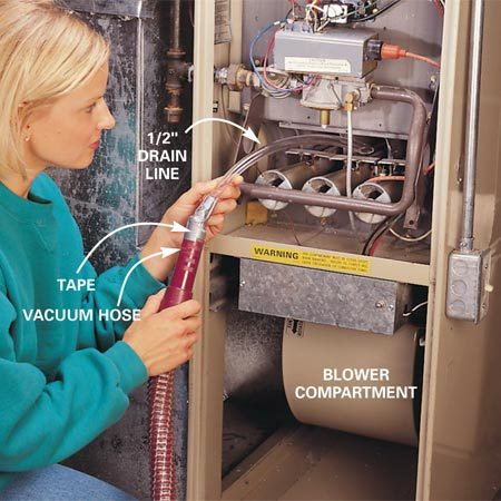 <b>Vacuum the burners</b></br> <p>Turn off the power switch again and shut off the gas   by giving the valve one-quarter turn. Vacuum the burners and   the furnace base. To get at the back of the burners, tape a 20-in.   length of 1/2-in. drain line to your vacuum hose. Vacuum everywhere   you see dust. While everything is open, use a flashlight to   look for signs of soot (fine black powder), which often indicates   poor combustion. Lift off the lower door   (blower door) and vacuum the  blower compartment. </p>