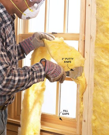 <b>Use a putty knife to stuff gaps with fiberglass</b></br> <p>The shim  space around windows and doors is a   prime spot  for air leakage. Stop these leaks by   reaching to  the back of this space with the straw type   nozzle  included with a can of expanding foam   insulation  and applying a bead around the   perimeter.  Let it cure at least an hour before stuffing   the remaining  space with a thin strip of fiberglass.   The  insulation should fit snugly, but don't pack it.</p>