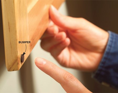 <b>Place bumpers at top and lower corners</b></br> <p>Tired of  listening to those cabinet   doors bang  shut? Peel-and-stick door   and drawer  bumpers are the   solution.  Get a pack of 20 at a   home center  for $2. Make sure   the back of  the door is clean so   the bumpers  will stick, then place   one at the  top corner and another at   the bottom. </p>