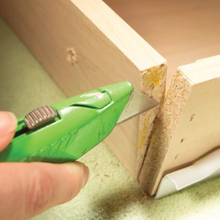 <b>Remove fasteners and old glue</b></br> <p>Don't put up  with a broken corner joint   on a drawer.  Fix it before the whole   drawer comes  apart. Remove the drawer   and then  remove the drawer front from   the drawer  box if possible. Most fronts   are fastened  by a couple of screws inside   the box.  Remove nails, staples or screws   from the  loose joint and scrape away old   glue with a  utility knife.</p>