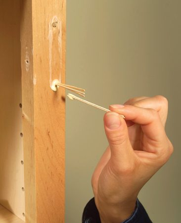 <b>Fill holes with toothpicks and glue</b></br> <p>If a screw  turns but doesn't tighten, the screw hole   is stripped.  Here's a quick remedy:   Remove the  screw and hardware.   Dip  toothpicks in glue, jam as many as   you can into  the hole and break them   off. Either  flat or round toothpicks will   work.  Immediately wipe   away glue  drips with a damp cloth. You   don't have  to wait for the glue to dry or   drill new  screw holes; just go ahead   and  reinstall the hardware by driving   screws right into the toothpicks. </p>
