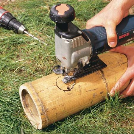 <b>Photo 10: Drill the spout hole</b></br> Drill a 3/8-in. pilot hole and cut out the spout hole with a jigsaw fitted with a fine-tooth blade. Shave the hole edges with a sharp utility knife until the spout fits snugly into the hole.