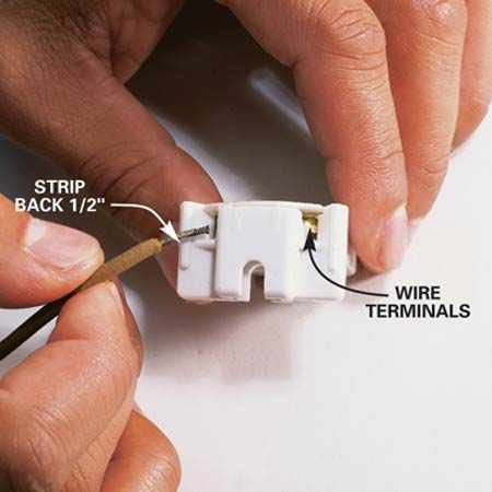 <b>Close up</b></br> Push the stripped wire into the new terminal, being careful to insert the correct wire into each terminal.