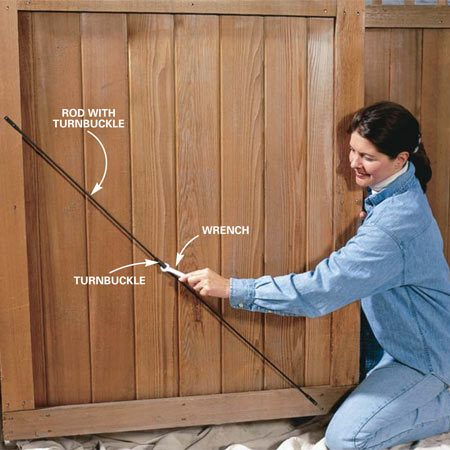 <b>Photo 5: Straighten gates and doors</b></br> Realign sagging gates with a turnbuckle. We spray-painted the shiny turnbuckle black to make it less conspicuous.