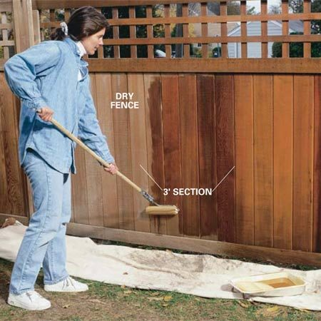 <b>Photo 7: Roll a section</b></br> Roll into the dry wood a soaking coat of semitransparent stain. Coat about 3 ft. of fence, then proceed to the step shown in Photo 8.
