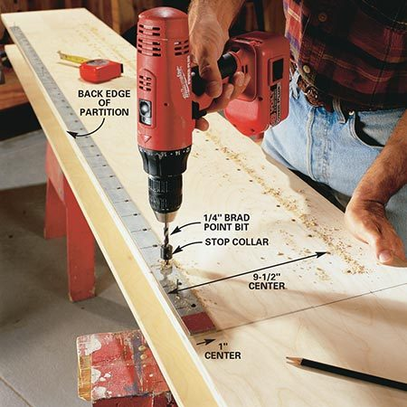 <b>Photo 3: Drill shelf pin holes</b></br> <p>Measure 12 in. down from the top of your partition and drill 1/4-in. holes, 1/2 in. deep, every 2 in. to accept the shelf pins. Ensure accuracy by making a drill guide from a steel strip, available at your hardware store. Mark one end with paint so you always know which end goes up, then drill three 1/16-in. holes evenly along the length so you can use brad nails to attach the guide to your work surface. You can also buy predrilled guides at homecenters or woodworking stores, or simply use strips of pegboard.</p>
