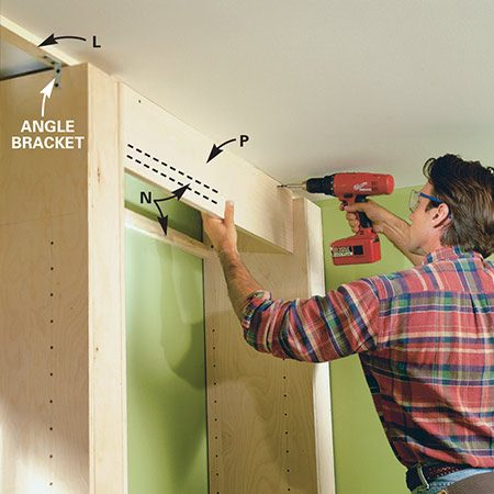 <b>Photo 9: Install the fascia</b></br> <p>Cut each fascia piece (P) to fit snugly between the partitions. Cut and fit the cleats (N) as well. Screw the fascia to the ceiling cleat with 1-5/8 in. wood or deck screws.</p>