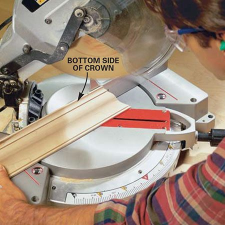 <b>Photo 14: Crown molding tip</b></br> <p>Cut your crown molding more safely and accurately by positioning the molding upside down on the miter saw bed. Mark the pieces so you can see the mark and slowly cut through the piece. Let the saw fall through the molding. Don't force the saw or hurry the cut.</p>
