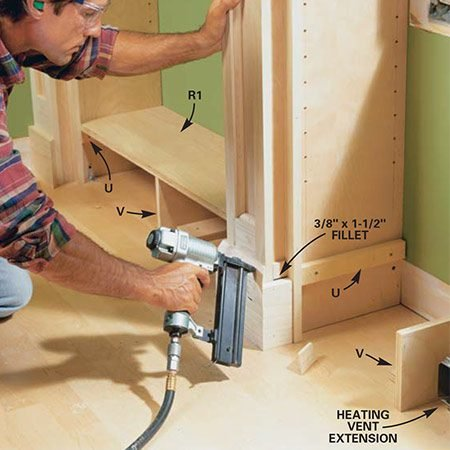 <b>Photo 15: Attach base molding and cleats</b></br> <p>Cut and nail the base molding to wrap around the face frame and partition sides. Note that you'll need small fillets to fill the gaps in the same way as you did at the top under the crown molding returns. Screw in cleats (U) 6-1/4 in. from the floor on the side of each partition. Also screw the floor cleats (V) to the floor to support the center of each base shelf (R).</p>