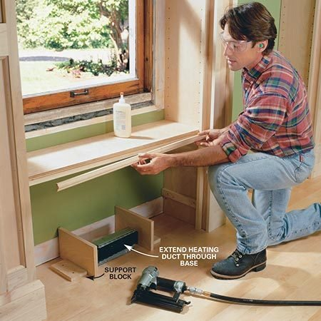 <b>Photo 17: Build the window seat</b></br> <p>Assemble the window seat by screwing cleats (U2) to the sides of each center partition and then nailing the seat to the cleats. <b>Note:</b> The seat is reinforced below by front and rear supports glued to the underside of the seat before it is nailed in place. Glue molding to the front of the seat, then nail the seat brackets and fillets in place as shown in Fig. A.</p>