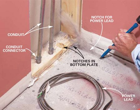 <b>Photo 4: Notch a path for the wires </b></br> Chisel a groove in the cement board for the enlarged portion of the power lead to nestle into. Notch the bottom plate of the wall to provide a pathway for the power lead, thermostat wires and conduit.