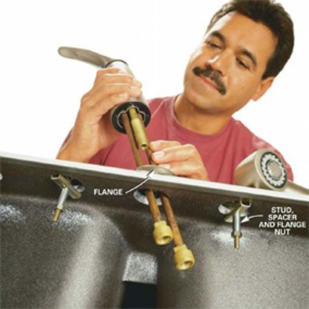 <b>Photo 5: Place the flange over the faucet opening </b></br> Follow any manufacturer's preassembly instructions and place the optional flange (see Photo 8) over the faucet opening. Finger-tighten the flange nuts underneath the sink and check the alignment of the flange, faucet and sink hole from above.