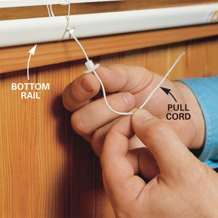 <b>Photo 3: Restring pull cord</b><br/>Slide the bottom rail back between the ladder cords. String the pull cords through the bottom rail and knot the ends. Tuck any loose cord ends into the holes before replacing the plugs.