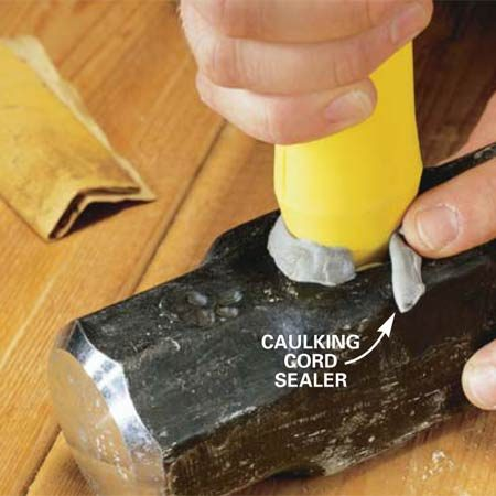 <b>Photo 3: Insert the handle</b></br> Clean the inside of the eyehole with sandpaper or a copper fitting brush. The scuffed surface helps the epoxy bond. Insert the handle core into the tool eyehole until the top is flush (Photo 4). Seal the gap between the handle and head with the supplied caulking cord sealer to keep the epoxy from leaking out.
