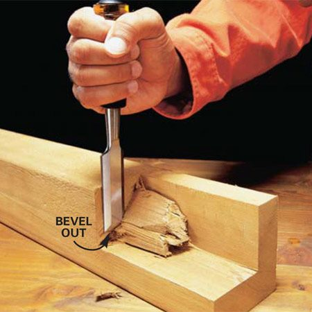 <b>Photo 3: Remove chunks of wood</b></br>       <p>Chop  out large Amounts of wood by slicing off small amounts with each cut. Strike  the chisel with a hammer and chop down about 1/2 in. Then chisel from the end  to remove the piece before continuing. Your chisel <em>must </em>be sharp for  this cut.</p>       <p><strong>Caution: </strong>Wear safety  glasses. </p>