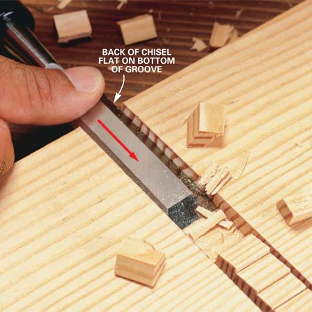 <b>Photo 5: Fine-tune the dado</b></br> Smooth and flatten the bottom of the dado. Keep the back of the chisel flat to the bottom of the groove. Work from both ends into the center to avoid splintering the edge.