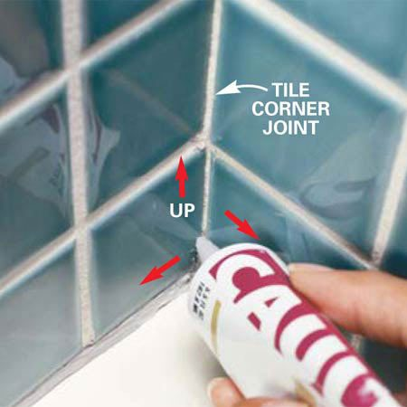 <b>Photo 6: Include the tile corner joint</b></br> Caulk up  the tile corner joint if the old caulk has cracked or deteriorated.