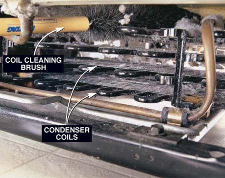 <b>Photo 2: Brush off the coils</b></br> Clean the coils with a special coil cleaning brush to loosen the dirt and dust. Vacuum the coils as you brush. Be careful not to bend the fan blades. A gentle brushing will do the job.