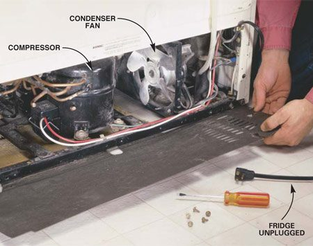 <b>Photo 1: Remove the lower back cover</b></br> Access the condenser fan by rolling the fridge away from the wall and removing the lower back cover with a screwdriver. Replace the cover when you're finished. It's essential for good air circulation.