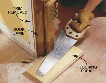 <b>Photo 2: Cut the door jambs </b></br> Undercut the door jambs (and the trim if it's staying on) with a handsaw. Use a piece of scrap flooring as a height guide; this allows the new flooring to slide underneath. Vacuum the whole floor thoroughly.