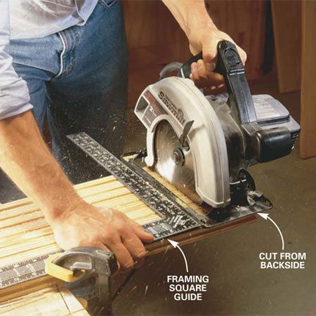 <b>Photo 4: Cut boards to length </b></br> Cut boards to length with a circular saw. Clamp on a guide to ensure square cuts and cut from the back side of the board (to minimize splintering the good side). If you use a sliding miter saw, cut with the good side up.