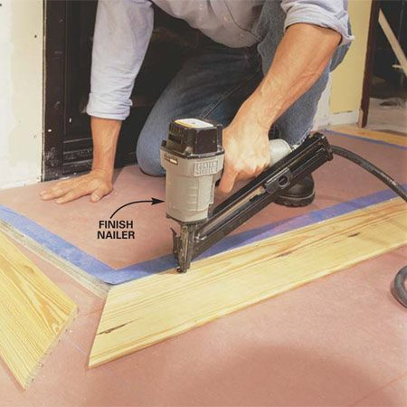 <b>Photo 11: Cut the flooring to fit around a hearth</b></br> Cut flooring to 6 in. wide to frame around the fireplace hearth. Nail these pieces with the tongue facing out. You'll groove the next floorboards to fit.